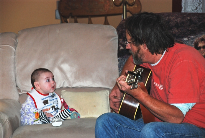 David and his granddaughter playing music
